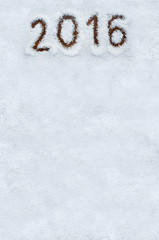 Text 2016 written on snow with wood background. Vertical holiday top view postcard with space for copy or lettering.