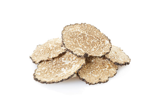 Black truffle slices heap isolated on white, clipping path