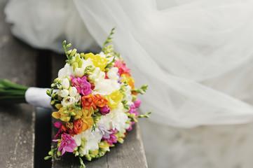 Wedding bouquet on wood surface. Summer wedding.