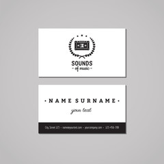 Music studio business card design concept. Music studio logo with music cassette and wreath. Vintage, hipster and retro style. Black and white.