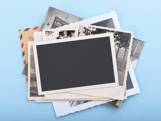 Stack of old photos on blue background