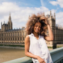 Happy young woman portrait in London on Westminster bridge.