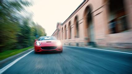 Cabriolet sportscar on the street. Radial defocused manipulation