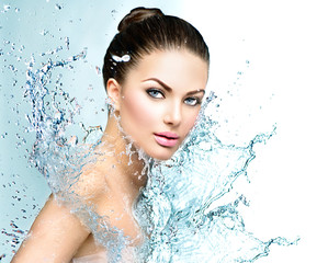 Beautiful model spa woman with splashes of water