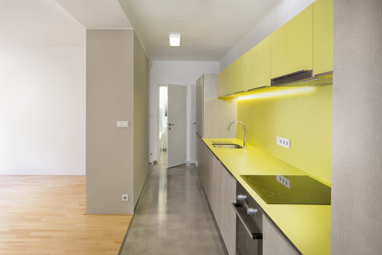 new design empty flat with new yellow  kitchen