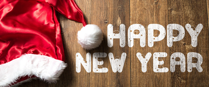 Happy New Year written on wooden with Santa Hat