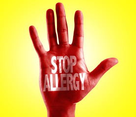 Stop Allergy written on hand with yellow background