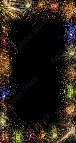 sparkling colorful fireworks frame border vertical black backgro