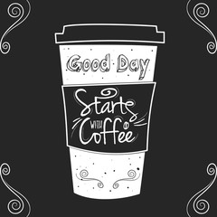 White cup of coffee on black board background with text and deco