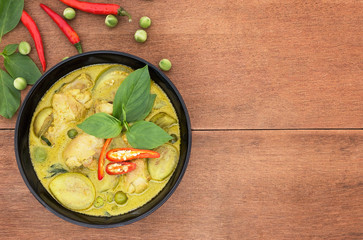 Thai chicken green curry with old wooden background