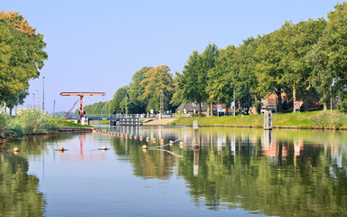 Fototapeten Kanal Wilhelmina channel with a drawbridge, Biest-Houtakker, The Netherlands.