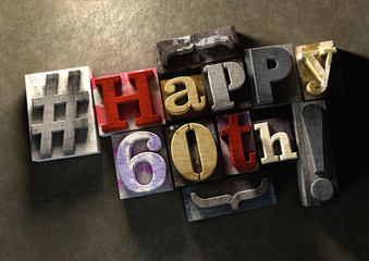 Ink splattered printing wood blocks with grungy Happy 60th birthday title text typography graphic background