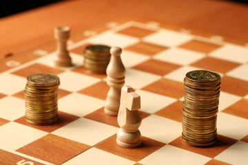 money as the coins are gold coins on the chessboard finance conc