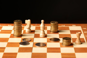 Coins on a chessboard. Finance concept. money concept