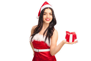 Woman in Santa costume holding a present