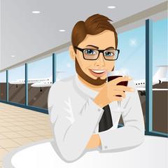 businessman drinking wine in restaurant