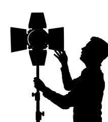 Photographer controls lighting equipment for photography