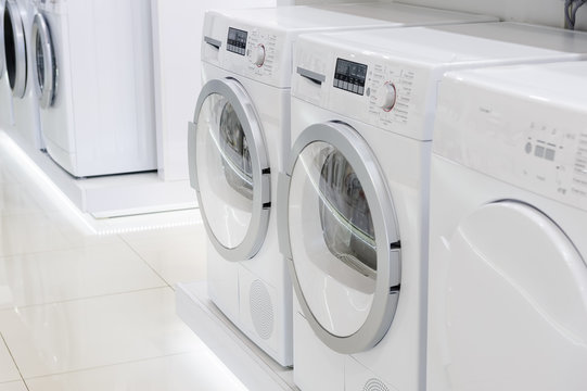 laudry dryers and washing mashines in appliance store