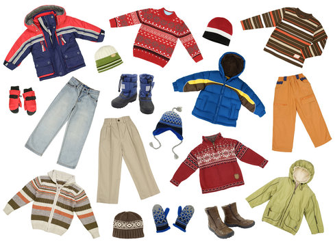Color- and size-coordinated collection of boys winter clothes, isolated on white