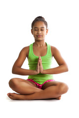 Girl doing is sitting with eyes closed in the lotus position