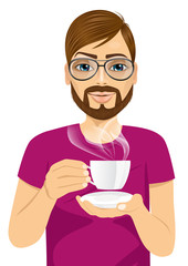 young man drinking hot coffee or tea