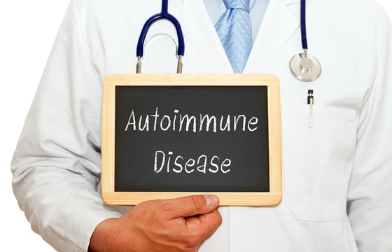 Autoimmune Disease - Doctor holding chalkboard with text on white background