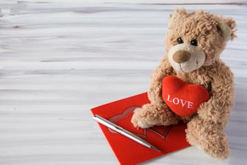 Romantic teddy bear on white
