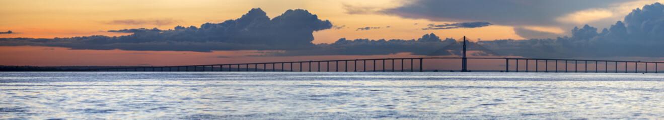 Sunset and Manaus Iranduba Bridge over the Amazon, Brazil