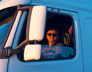 Driver in the cabin of him truck