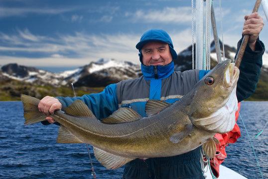 Fisherman on the boat near Lofoten island