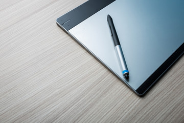 Graphic tablet with Pen. Big picture of digitizer device with digital pen on the table. Creative draw tool for designers. Icon of tablet display near multimedia pencil sketching.