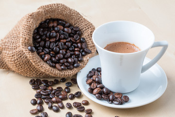 Cup of coffee and fresh roasted organic Coffee beans on isolated background, food and drink background