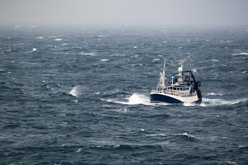 Ship in the tempest in north sea