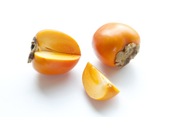 Ripe persimmon with cut isolated on white background. Clipping Path