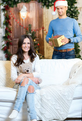 Ready to accept Christmas presents. Couple in love is in festive