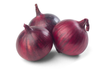 ripe red onions on a white background