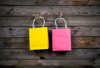 Shopping bags on a wooden background, sale, purchase
