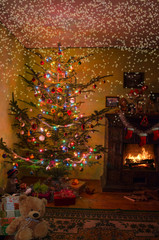 Holiday living room with the Christmas tree, gifts and a firepla