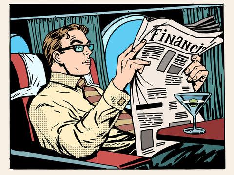 Business class plane businessman reads the press