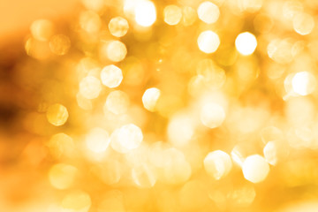 the Abstract blur golden bokeh lighting for holiday background