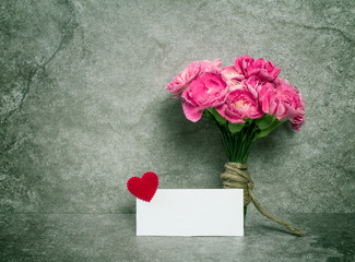 Fresh pink carnation flower and blank card for copy space
