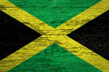 Jamaica Flag painted on old wood background