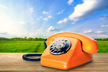 Orange phone outdoors