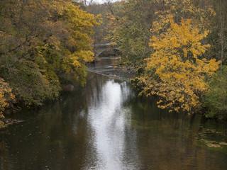 Fabulous autumn  landscape beyond a water