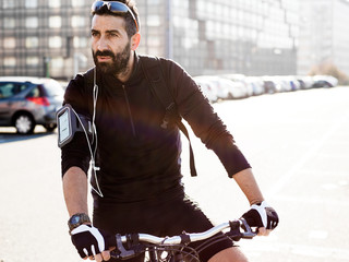 Handsome sportsman portrait cycling in the city