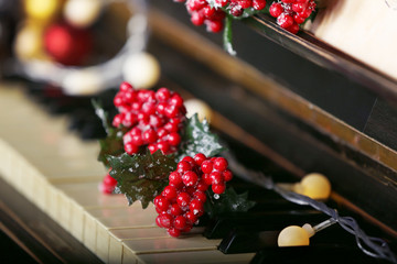 Piano keys decorated with Christmas decorations, close up