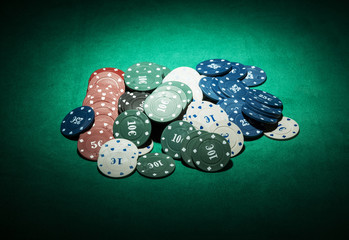 Casino chips close-up on green cloth