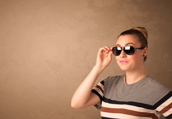 Portrait of a young pretty woman with sunglasses and copyspace