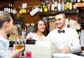 Beautiful employees working in bar