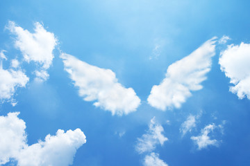 Angel wings formed from clouds. Wall mural